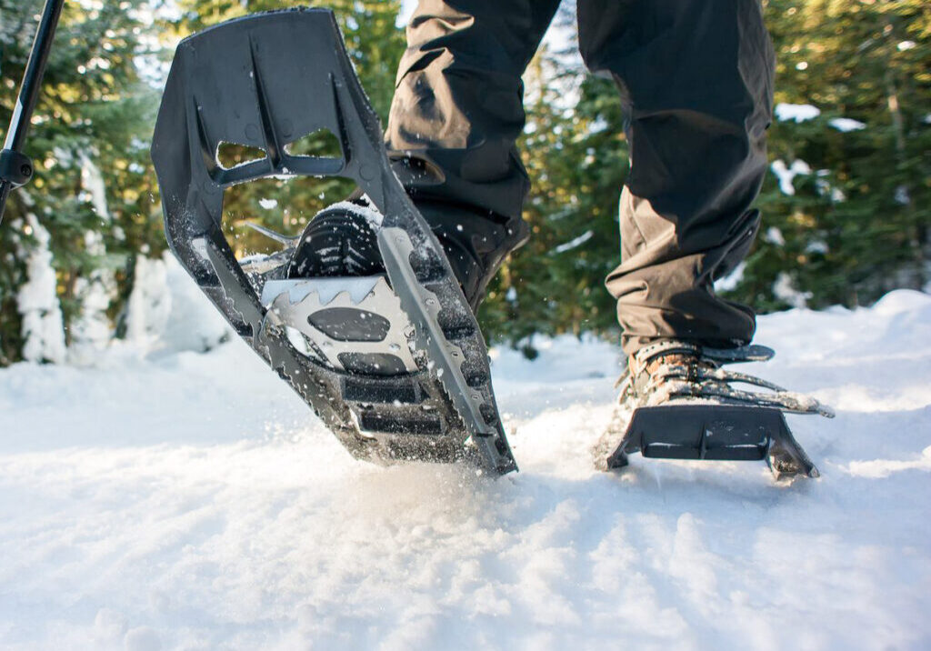 closeup-of-hiker-snowshoeing-on-trail-through-royalty-free-image-1605811873.